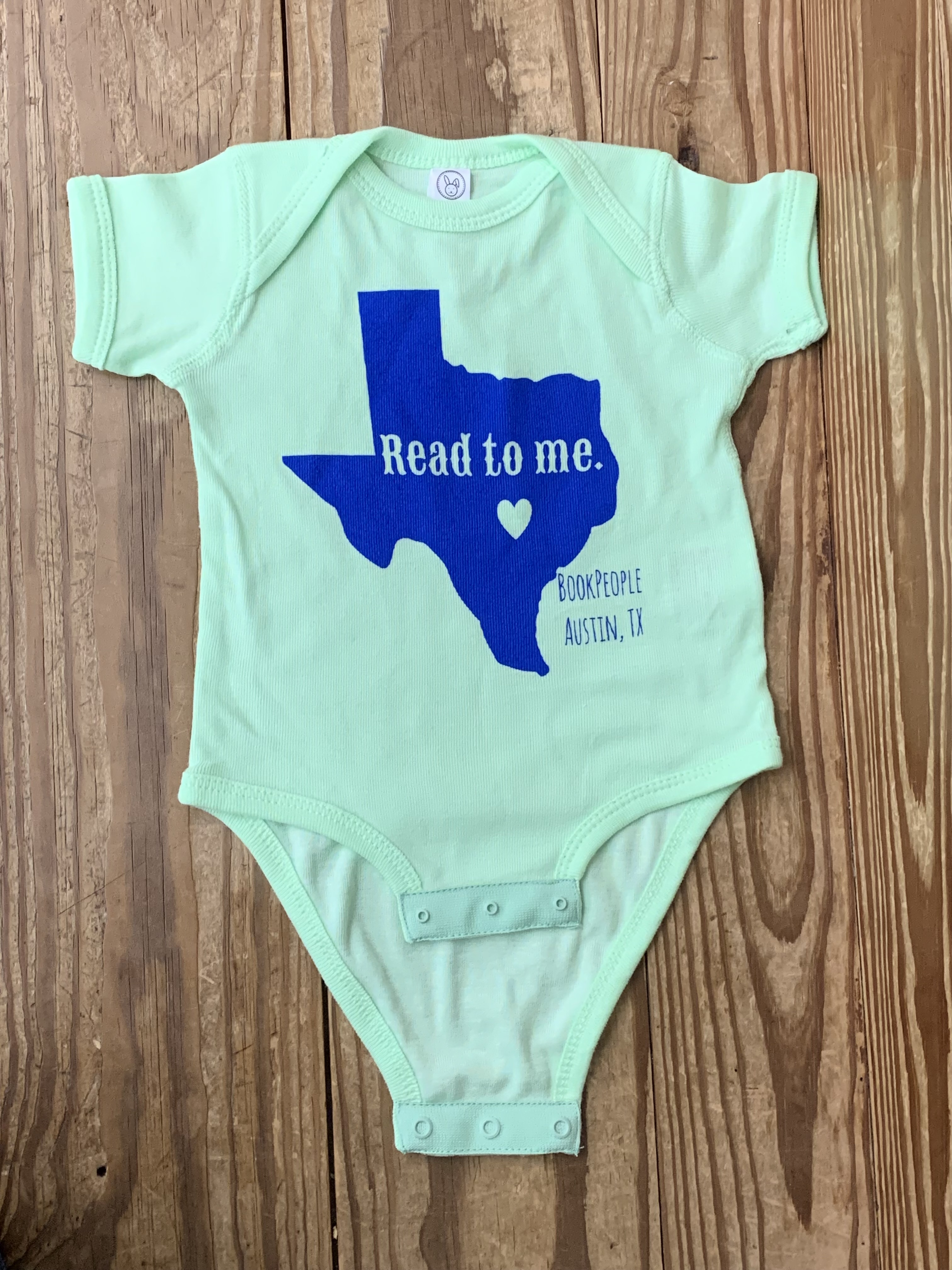 Mint green onesie with blue ink
