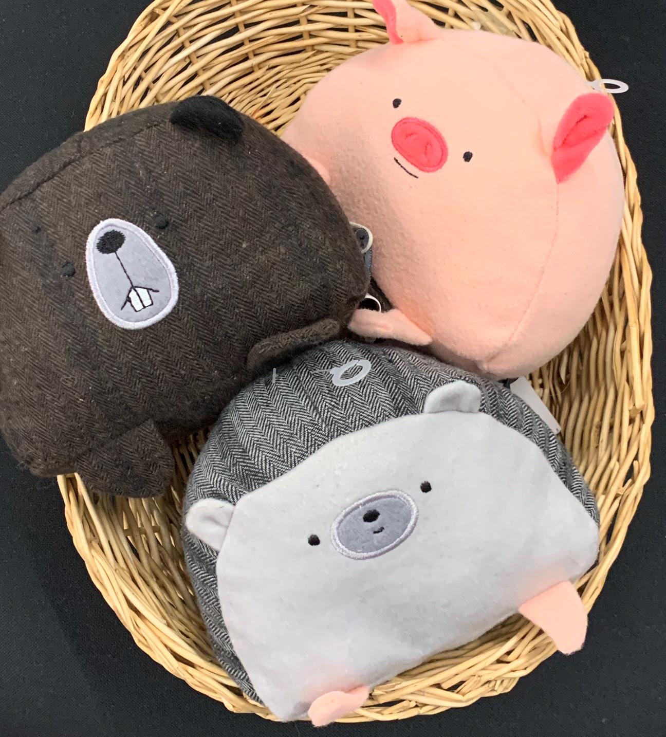 Three cute animal chew toys in a basket