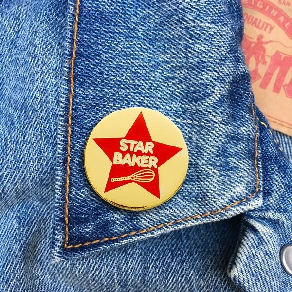 Star Baker pinned onto a lapel